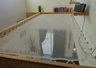 Pose d'un filet de Catamaran dans une maison